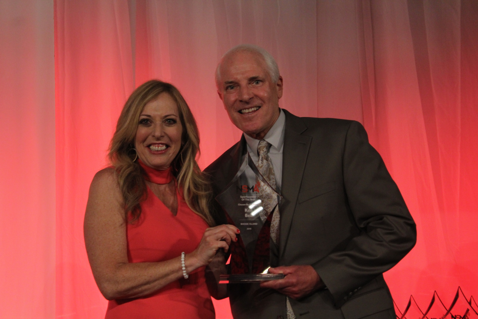 Ken Bell receives his 2016 NSMA Rhode Island Sportscaster of the Year award from ESPN's Linda Cohn, June 26, 2017 (Daniel Coston Photo - All Rights Reserved)