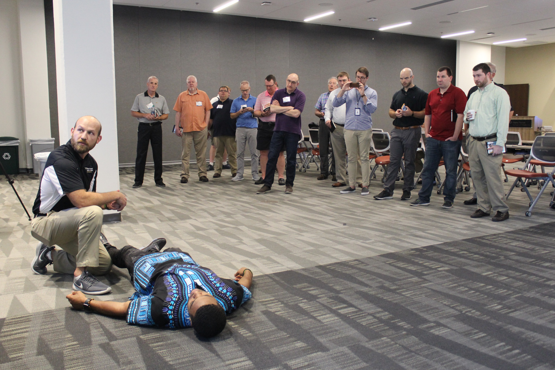 Wake Forest assistant athletic trainer Niles Fleet demonstrates protocol for knee injuries at the Sports Medicine Summit on June 24, 2018, at Wake Forest University School of Medicine